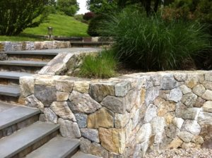 Stone and slate retaining wall and step stairs designed and installed by Gossett Brothers Nursery, South Salem, NY